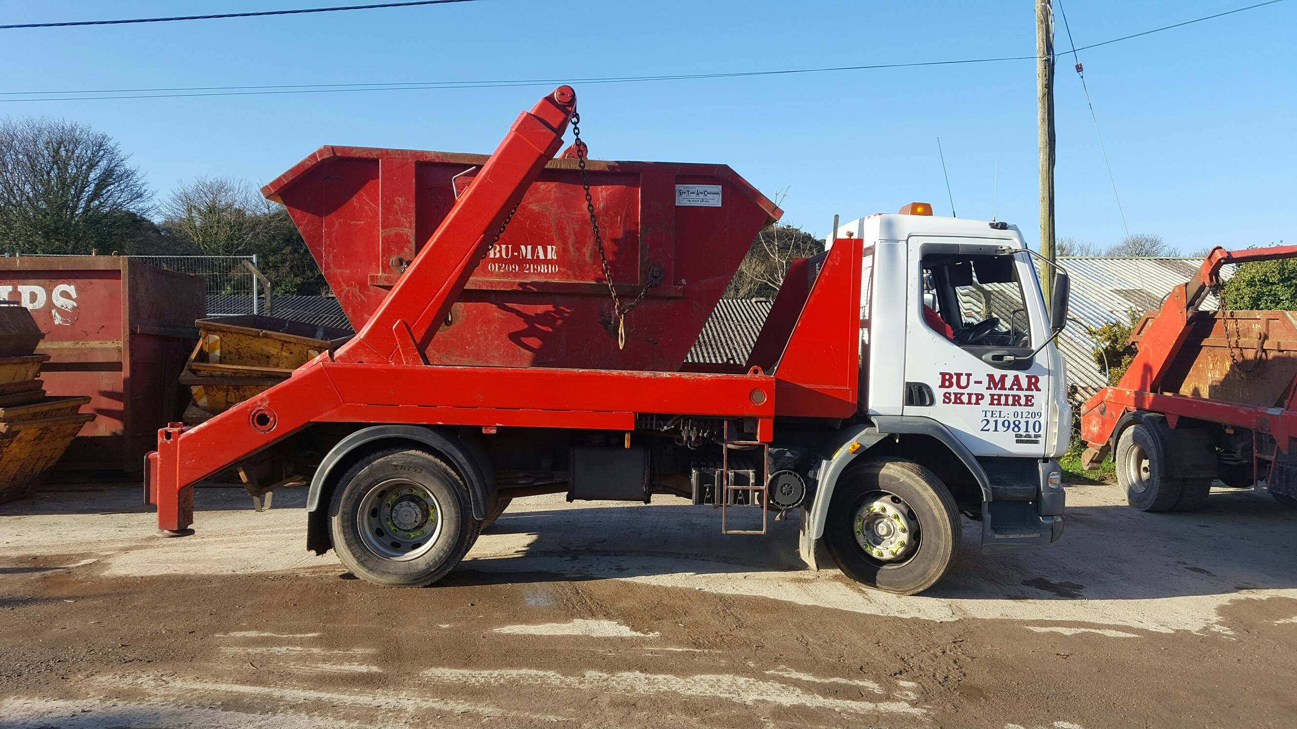 Bu-Mar Skip hire Lorry with Skip image