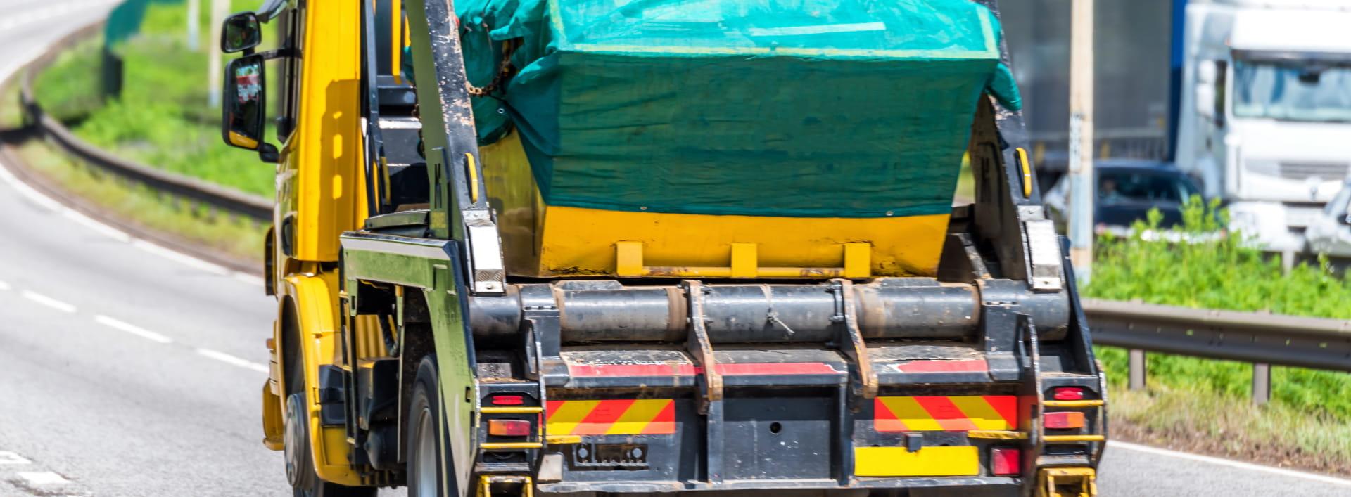 covered skip on skip truck